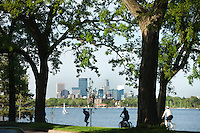 Summer scene as bikers, roller bladers and walkers enjoy a beautiful day along the park trails of Lake Calhoun in Minneapolis, Minnesota.