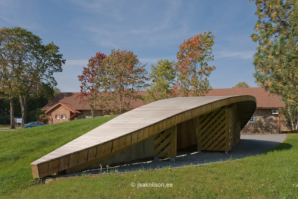 Wooden modern abstract storage building with walkway in Estonian Road museum