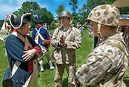 Tracey Fallon (L) of the Second Pennsylvania Regiment speaks with World War II reenactors Matt Naudasher (C) and Matt Davenport (R) during the Hatboro Tricentennial celebration at Pennypack Elementary School Saturday June 13, 2015 in Hatboro, Pennsylvania.  (Photo by William Thomas Cain/Cain Images)
