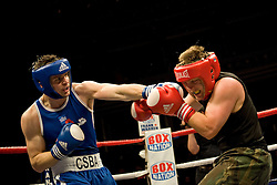 © Licensed to London News Pictures. London, UK  07/10/2011. PAUL ORMSTON, Royal Navy (left) Vs ANGELO LANERO, US Naval Academy (right). Members of the UK and US Armed Forces take part in the Royal Albert Hall cup boxing match. This is the first time a boxing event has taken place in the historic venue following a court ruling banning the use of the hall for boxing and wrestling in 1999. The Court of Appeal subsequently overturned the decision earlier this year. The venue has hosted some of the greatest names in British boxing including Sir Henry Cooper, Frank Bruno, Lennox Lewis and Prince Naseem Hamed. Photo credit: Ben Cawthra/LNP
