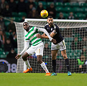 4th April 2018, Celtic Park, Glasgow, Scotland; Scottish Premier League football, Celtic versus Dundee; Steven Caulker of Dundee clears from Odsonne Edouard of Celtic