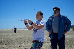 """Wildwoods International Kite Festival, Jersey Shore, NJ USA - May 26, 2013; Kite instructor Forrest Cary watches as student Ben Franco flies a double-lined stunt kite...( Part of a reportage published on WHYY's NewsWorks.org May 29, 2013: """"High flyers compete at Wildwood kite festival"""" - http://shar.es/w02y1 )"""