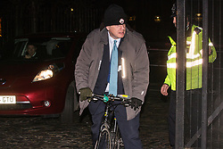 London, UK. 20th March, 2019. Boris Johnson, Conservative MP for Uxbridge and South Ruislip, leaves the House of Commons on his bicycle on the evening that Prime Minister Theresa May was meeting Opposition leaders to discuss extending Article 50 before travelling to Brussels tomorrow for an EU summit.