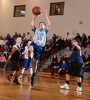 Gilford's Alex Cheek goes up for the basket during the Senior Boys division game with Sanbornton during the 21st annual Francoeur Babcock Basketball Tournament Friday evening.  (Karen Bobotas/for the Laconia Daily Sun)
