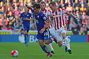 Leicester City's Shinji Okazaki wins the ball from Stoke City's Glenn Whelan during the Barclays Premier League match between Stoke City and Leicester City at the Britannia Stadium, Stoke-on-Trent, England on 19 September 2015. Photo by Aaron Lupton.