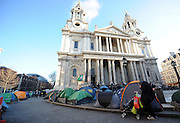 A women stands with her belongings on a pushchair at Occupy London on the grounds of St Pauls Cathedral opposite Londons Stock Exchange on January 11th 2011...Photo Ki Price.