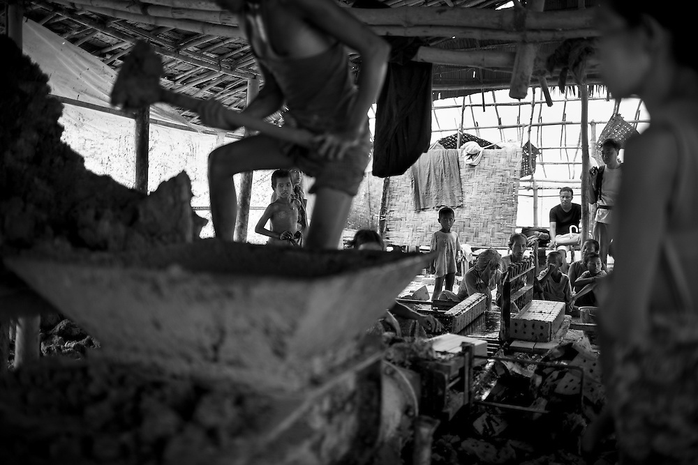 A brick factory on the rural outskirts of Yangon, Myanmar. Workers, including children, earn about one dollar fifty for a full day of manual labor.