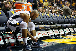 Feb 12, 2018; Morgantown, WV, USA; West Virginia Mountaineers guard Jevon Carter (2) changes shoes during a timeout during the first half against the TCU Horned Frogs at WVU Coliseum. Mandatory Credit: Ben Queen-USA TODAY Sports