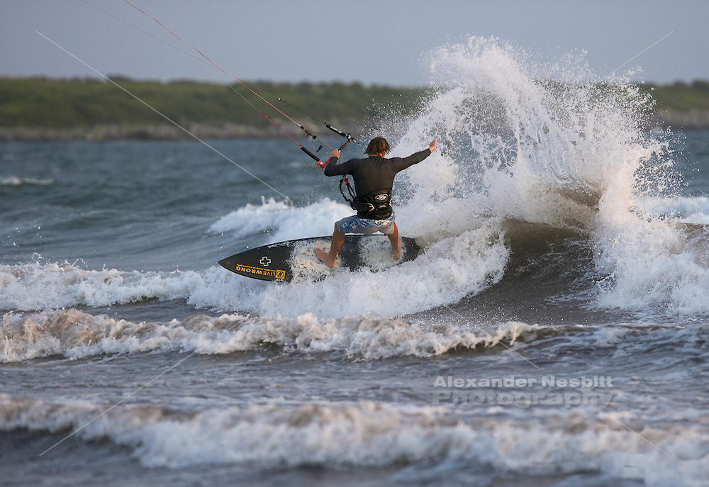 Sachuest Beach, Middletown, RI - Christian Schlebach slams a heel side on strapless carbon surfboard