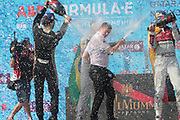 ALAN McNISH, Team Manager AUDI formula E - the Team trophy for best performance in the 2018 season has been handed to ALAN McNISH, Team Manager AUDI formula E - podium celebration with Champaign by team AUDI SPORT - ABT Schaeffler drivers Luca di Grassi and Daniel ABT. <br /> USA e-Prix, FIA Formula E, Formula E Grand Prix at the red hook Brooklyn New York harbor area on 15 July, 2018. Formel E in New York, Brooklyn, Red Hook port area. <br /> fee liable image, copyright@ ATP Arthur THILL