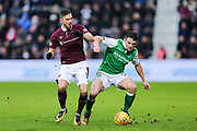 John McGinn (#7) of Hibernian drives the ball forward under pressure from Manuel Milinkovic (#11) of Heart of Midlothian during the William Hill Scottish Cup 4th round match between Heart of Midlothian and Hibernian at Tynecastle Stadium, Gorgie, Scotland on 21 January 2018. Photo by Craig Doyle.