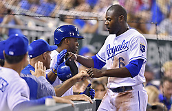 April 13, 2017 - Kansas City, MO, USA - The Kansas City Royals' Lorenzo Cain (6) is greeted after scoring on a sacrifice fly by Brandon Moss in the third inning against the Oakland Athletics at Kauffman Stadium in Kansas City, Mo., on Thursday, April 13, 2017. (Credit Image: © John Sleezer/TNS via ZUMA Wire)