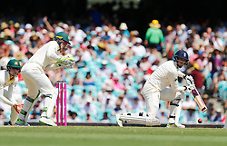 England's James Vince plays a shot as Tim Paine looks on during day four of the Ashes Test match at Sydney Cricket Ground.