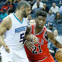 03 November 2015: Chicago Bulls guard Jimmy Butler (21) drives past Charlotte Hornets forward Nicolas Batum (5) during the Charlotte Hornets  130-105 victory over the Chicago Bulls, at the Time Warner Cable Arena, in Charlotte, North Carolina, USA.