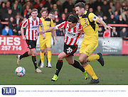 Dan Holman and Rob Swaine during the Vanarama National League match between Cheltenham Town and Bromley at Whaddon Road, Cheltenham, England on 30 January 2016. Photo by Antony Thompson.