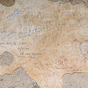 Graffiti on plaster at Iglesia y Convento de La Recolección in Antigua, Guatemala.