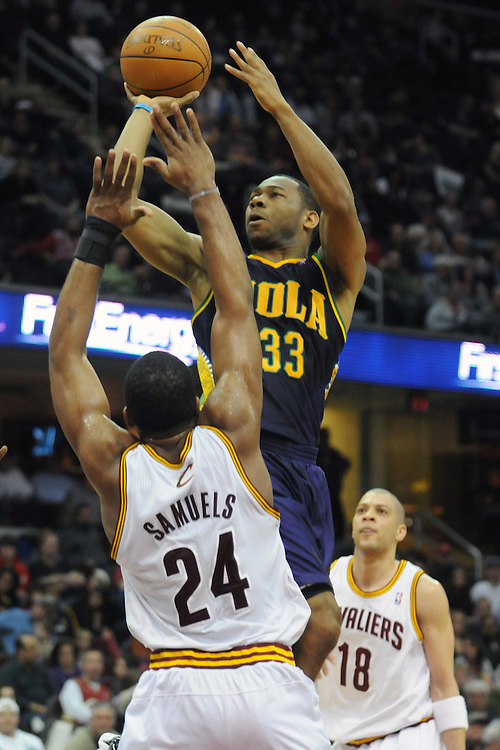 March 6, 2011; Cleveland, OH, USA; New Orleans Hornets shooting guard Willie Green (33) shoots over Cleveland Cavaliers power forward Samardo Samuels (24) and shooting guard Anthony Parker (18) during the third quarter at Quicken Loans Arena. Mandatory Credit: Jason Miller-US PRESSWIRE