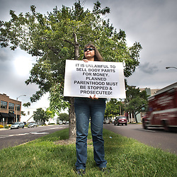 Lisa Johnston  |  lisajohnston@archstl.org  |  @aeternusphoto  After recent videos from an antiabortion group were released apparently showing a Planned Parenthood official discussing the method and price of providing fetal tissue left over from abortions for medical research, protesters gathered outside of the Planned Parenthood facility on Forest Park Blvd. in St. Louis. Judy Maichel stood across the street from Planned Parenthood to raise public awareness to the latest news.