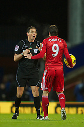 BLACKBURN, ENGLAND - Wednesday, January 5, 2011: Referee Andre Marriner argues with Liverpool's Fernando Torres during the Premiership match against Blackburn Rovers at Ewood Park. (Pic by: David Rawcliffe/Propaganda)