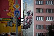 Riesige Werbung an einem Plattenbau fuer den neuen Skoda Superb in der Naehe der Skoda Autowerke im Zentrum von Mlada Boleslav. Mlada Boleslav liegt noerdlich von Prag und ist ungefaehr 60 Kilometer von der tschechischen Haupstadt entfernt. Skoda Auto beschäftigt in Tschechien 23.976 Mitarbeiter (Stand 2006), den Grossteil davon in der Zentrale in Mlada Boleslav. Damit sind mehr als 3/4 aller Erwerbstätigen der Stadt in dem Automobilkonzern tätig.<br /> <br />                                        Bigboard commercial at a panel house close to the Skoda factory in the city of Mlada Boleslav. The city is located north of Prague and about 60 km away from the Czech capital. Skoda Auto has about 23.976 employees (2006) in Czech Republic and a big part of them is working in Mlada Boleslav. 3/4 of the working population in Mlada Boleslav is working for the Skoda Auto company.