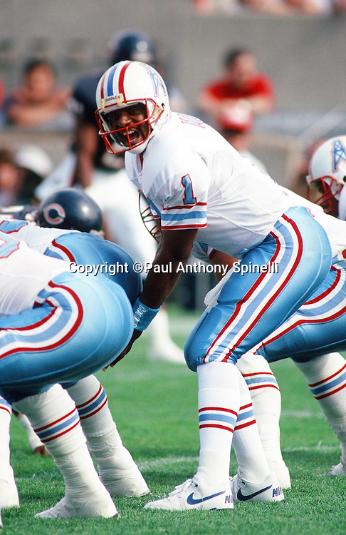 Houston Oilers quarterback Warren Moon (1) calls out signals over center during the NFL football game against the Chicago Bears on Oct. 15, 1989 in Chicago. The Oilers won the game 33-28. (©Paul Anthony Spinelli)