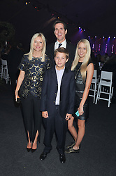 Left to right, CROWN PRINCE PAVLOS OF GREECE, CROWN PRINCESS MARIE CHANTAL OF GREECE and their children PRINCESS OLYMPIA OF GREECE and PRINCE ACHILEAS-ANDREAS (Check!) at Gabrielle's Gala an annual fundraising evening in aid of Gabrielle's Angel Foundation for Cancer Research held at Battersea Power Station, London on 2nd May 2013.