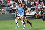 Manchester City midfielder Jill Scott (8) receives a pass while North Carolina Courage midfielder Debinha (10) runs to pressure the ball during an International Champions Cup women's soccer game, Thurday, Aug. 15, 2019, in Cary, NC. The North Carolina Courage defeated Manchester City Women 2-1.  (Brian Villanueva/Image of Sport)