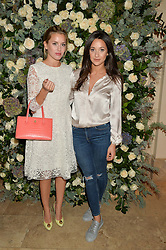 Left to right, CAGGIE DUNLOP and ROXIE NAFOUSI at a private view of the Beulah Winter Autumn Winter collection entitled 'Chrysalis' held at The South Kensington Club, London SW7 on 24th September 2015.