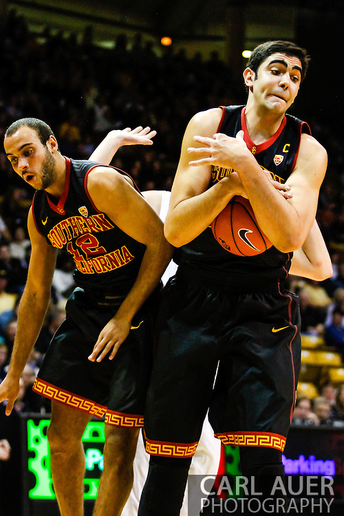 January 18th, 2014:  USC Trojans senior center Omar Oraby (55) secures a rebound in the second half of the NCAA Basketball game between the USC Trojans and the University of Colorado Buffaloes at the Coors Events Center in Boulder, Colorado
