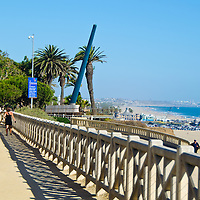 "PALISADES PARK: This lush, 25-acre park overlooking the Pacific is a wonderful place for walkers, bikers and people watchers, and connects with the broad Santa Monica beach made famous in TV's ""Baywatch"" episodes. Palisades Park was given to the city in 1892 for use as a park ""forever"" by Santa Monica's founders, Col. Robert Baker and his partner, Senator John P. Jones. From this slender, 26-acre park set on a cliff and running from Colorado Avenue to just north of San Vicente Boulevard, you'll be treated to breathtaking views of the Bay, which stretches before you from Palos Verdes Peninsula to Malibu. Whether you're coming to rest and enjoy its lawn and palms, or to jog along its paths, Palisades Park is a great place above it all. There is also a Visitors Center located here for information on the area. (Wednesday, 19, 2013)"