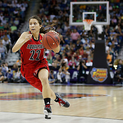 April 7, 2013; New Orleans, LA, USA; Louisville Cardinals guard Jude Schimmel (22) dribbles against the California Golden Bears during the second half in the semifinals during the 2013 NCAA womens Final Four at the New Orleans Arena. Mandatory Credit: Derick E. Hingle-USA TODAY Sports