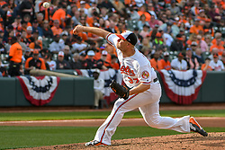 March 29, 2018 - Baltimore, MD, U.S. - BALTIMORE, MD - MARCH 29: Baltimore Orioles starting pitcher Dylan Bundy (37) pitches during the Opening Day game between the Minnesota Twins and the Baltimore Orioles on March 29, 2018, at Orioles Park at Camden Yards in Baltimore, MD.  The Baltimore Orioles defeated the Minnesota Twins, 3-2 in eleven innings.  (Photo by Mark Goldman/Icon Sportswire) (Credit Image: © Mark Goldman/Icon SMI via ZUMA Press)