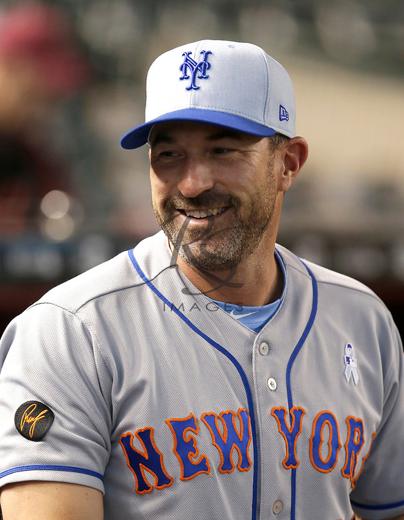 New York Mets manager Mickey Callaway (36) in the first inning during a baseball game against the Arizona Diamondbacks, Sunday, June 17, 2018, in Phoenix. (AP Photo/Rick Scuteri)