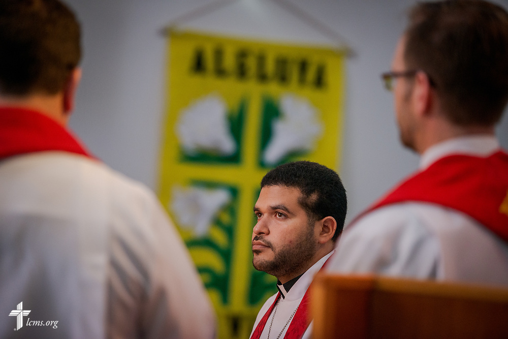 The Rev. Gustavo Maita listens as he is installed as pastor of Iglesia Luterana Principe de Paz (Prince of Peace Lutheran Church), Mayagüez, Puerto Rico, at the church on Sunday, April 15, 2018. LCMS Communications/Erik M. Lunsford