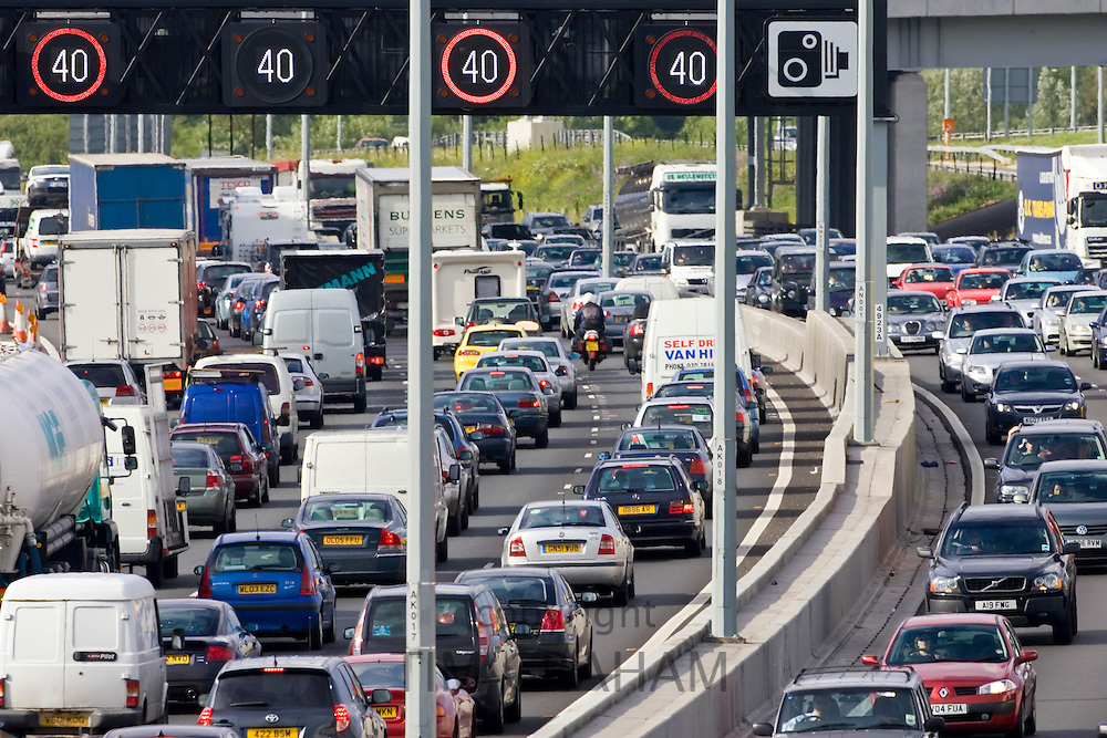 Traffic congestion for cars and trucks in both carriageways on M25 motorway, London, United Kingdom