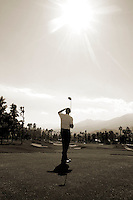 24 January 2009: Celebrity golfer Michael Bolton at Palmer Private at PGA West in La Quinta, California during the fourth round of play at the 50th Bob Hope Classic, PGA golf tournament.  Vertical sepia tone conversion.