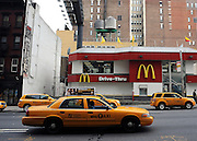 © licensed to London News Pictures. New York, USA  29/05/11.  New York cabs pass by a drive through McDonald's Restaurant in the East Village. Photo credit should read Stephen Simpson/LNP