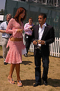 Natalya Petouchkova and Simon Kassianides. Veuve Clicquot Gold Cup Final at Cowdray Park. Midhurst. 17 July 2005. ONE TIME USE ONLY - DO NOT ARCHIVE  © Copyright Photograph by Dafydd Jones 66 Stockwell Park Rd. London SW9 0DA Tel 020 7733 0108 www.dafjones.com