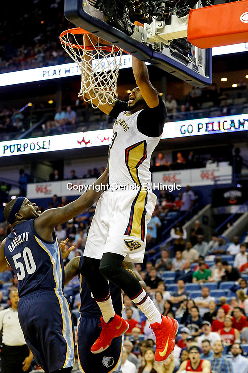 Mar 21, 2017; New Orleans, LA, USA; New Orleans Pelicans forward Anthony Davis (23) dunks over Memphis Grizzlies forward Zach Randolph (50) during the second half of a game at the Smoothie King Center. The Pelicans defeated the Grizzlies 95-82. Mandatory Credit: Derick E. Hingle-USA TODAY Sports