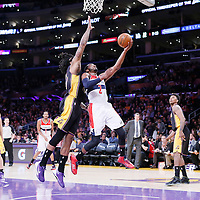 21 March 2014: Washington Wizards guard John Wall (2) goes for the layup past Los Angeles Lakers forward Jordan Hill (27) during the Washington Wizards 117-107 victory over the Los Angeles Lakers at the Staples Center, Los Angeles, California, USA.