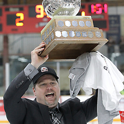 TRENTON, ON - Apr 22, 2016 -  Ontario Junior Hockey League game action between Trenton Golden Hawks and the Georgetown Raiders. Game 5 of the Buckland Cup Championship Series  at the Duncan Memorial Gardens in Trenton, Ontario. Assistant Coach of the Trenton Golden Hawks hoists the Buckland Cup.<br /> (Photo by Tim Bates / OJHL Images)