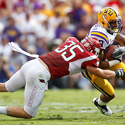 November 25, 2011; Baton Rouge, LA, USA;  LSU Tigers wide receiver Odell Beckham (33) is tackled by Arkansas Razorbacks linebacker Ross Rasner (35)during the second quarter of a game at Tiger Stadium.  Mandatory Credit: Derick E. Hingle-US PRESSWIRE