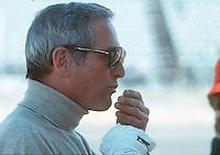 Film actor Paul Newman eating popcorn at Indanapolis in 1979..