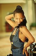 CUBA, SANTIAGO DE CUBA..Young lady at the bar of a tourist hotel..(Photo by Heimo Aga)