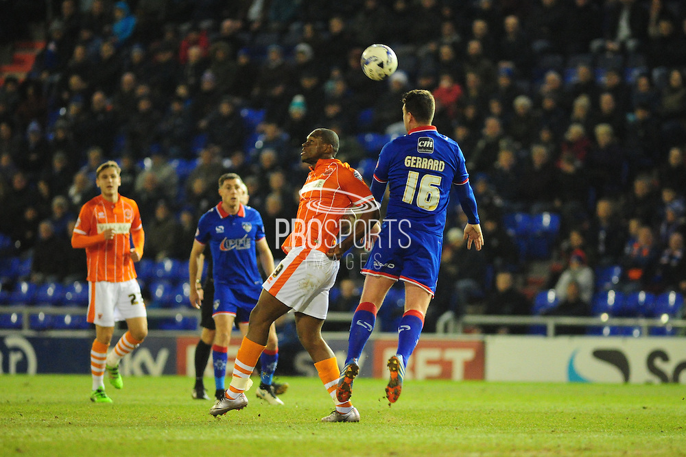 Anthony Gerrard of Oldham Athletic heads clear from Uche Ikpeazu of Blackpool FC (On loan from Watford FC) during the Sky Bet League 1 match between Oldham Athletic and Blackpool at SportsDirect.Com Park, Oldham, England on 15 March 2016. Photo by Mike Sheridan.