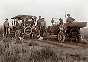 North Dakota Hunters with vintage autos, guns, hunting dogs  and various game they killed 1916