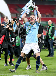Manchester City's Oleksandr Zinchenko celebrates with the trophy after his team win the Carabao Cup Final at Wembley Stadium, London.
