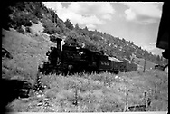 """Leased D&RGW K-27 #463 switching two gondolas at Porter.<br /> RGS  Porter, CO  Taken by Richardson, Robert W. - Oct. ? 8/10/1949<br /> In book """"Durango: Always a Railroad Town (1st ed.)"""" page 98<br /> Thanks to Don Bergman for additional information.<br /> Same image as RD146-141.  Dorman's book dates this as 10/10/1949"""