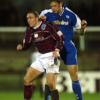 Arbroath v St Johnstone..  01.01.03<br />Ian Maxwell clears from Craig Feroz<br /><br />Pic by Graeme Hart<br />Copyright Perthshire Picture Agency<br />Tel: 01738 623350 / 07990 594431