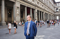 FLORENCE, ITALY - 29 JUNE 2016: The new director of the Uffizi Gallery Eike Schmidt poses for a portait in the portico of the Uffizi Gallery in Florence, Italy, on June 29th 2016.<br /> <br /> Art historian Eike Schmidt, former curator and head of the Department of Sculpture, Applied Art and Textiles at the Minneapolis Institute of Arts, became the first non-Italian director of the Uffizi in August 2015, replacing Antonio Natali who directed the gallery for 9 years. One of the main goals of the new director is to open the Vasari Corridor to the general public. Currently the corridor can only be visited with group reservations made by external tour and travel agencies throughout the year.<br /> <br /> The Vasari Corridor is is a 1-kilometer-long (more than half mile) elevated enclosed passageway which connects the Palazzo Vecchio with the Palazzo Pitti, passing through the Uffizi Gallery and crossing the Ponte Vecchio above the Arno River, in Florence. The passageway was designed and built in 1564 by Giorgio Vasari in only 6 months to allow Cosimo de' Medici and other Florentine elite to walk safely through the city, from the seat of power in Palazzo Vecchio to their private residence, Palazzo Pitti. The passageway contains over 1000 paintings, dating from the 17th and 18th centuries, including the largest and very important collection of self-portraits by some of the most famous masters of painting from the 16th to the 20th century, including Filippo Lippi, Rembrandt, Velazquez, Delacroix and Ensor.